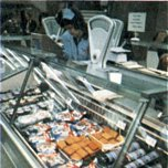 Some large Woolworth stores complemented their grocery offer with a selection of cooked meats and fresh fish, which were sold be weight at personal service counters.