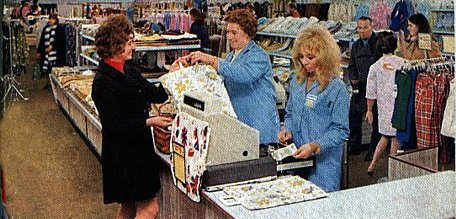 "The new Woolworths store in Basingstoke, which relocated into the town's new shopping centre in 1971, was pictured to celebrate ""D"" day (decimalisation) in February 1971. This picture shows the cash wrap desk on the Upper Floor adjacent to the Clothing Department."