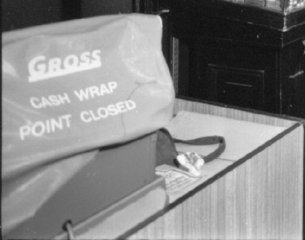 A Gross cash register under a dust cover, pictured in the F. W. Woolworth store in Stone, Staffordshire, UK in 1973