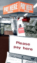 """Please pay here"" a new sign that appeared in over 1,000 British Woolworths stores as they converted to self-service between 1970 and 1976"