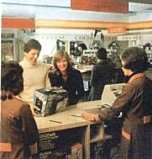 Job done and smiles all round as a couple collect their order from a Shoppers World store in 1975
