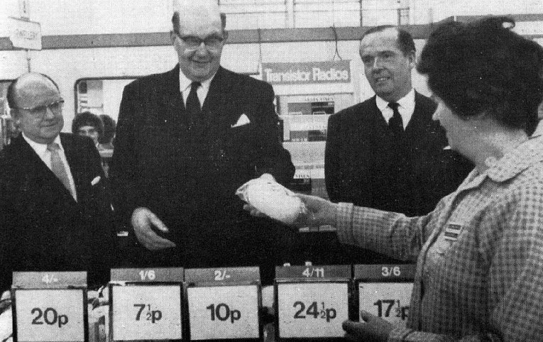 Lord Fiske, Chairman of the Decimal Currency Board, makes an inaugural decimal purchase in the Woolworth store in The Strand, London, WC2. This picture appeared in the London Times the day after decimalisation, 16 February 1971.