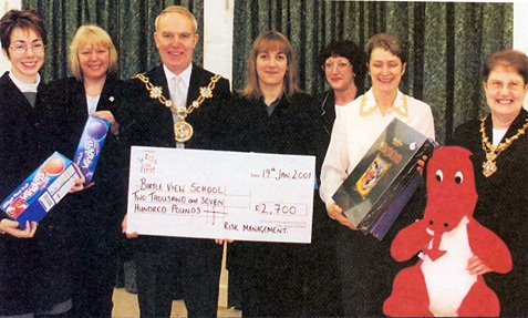 Members of the Castleton Risk Management Team handing over a cheque for £2700 for Belle View School to the Mayor and Mayoress of Rochdale