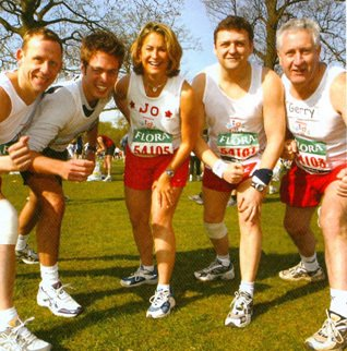 Classless culture in action as the Chief Executive joins four colleagues who successfully completed the London Marathon in 2003 (Left to right Andrew Mann, Ed(ward) Preston, Joanna Mills, CEO Trevor Bish-Jones and Gerry McEvoy)