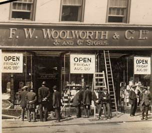 The Construction Team look-on as the District Manager admires his new F. W. Woolworth shop, due to open the next day