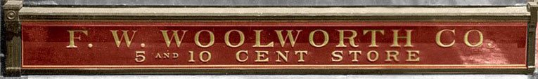 F. W. Woolworth Co. fascia - which first appeared in 1912. The & (ampersand) which first appeared in 1905 had disappeared.