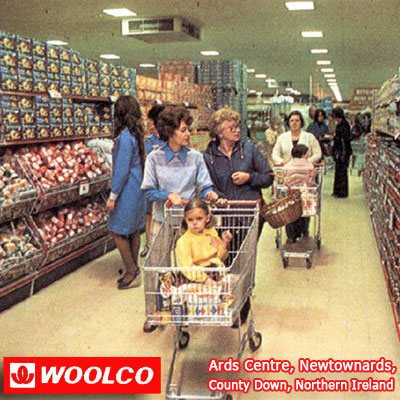 Wide, tall aisles of groceries in the new look Woolco hypermarket in the Ards Centre, Newtownards, County Down, Northern Ireland in 1976