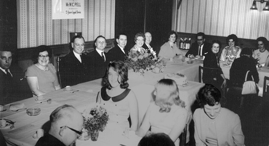A celebratory dinner to mark William Pell's 21 years service at Woolworth's in March 1965