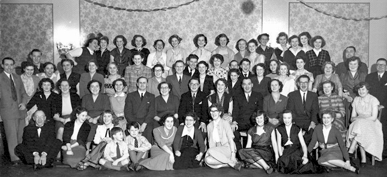 Christmas celebrations at the Taunton Woolworth's provided an opportunity for all of the staff and management to let their hair down.  The Manager, Mr. B.K.R. Manley is in the centre of the photograph, with Bill and Joan Pell on his right. Bill's new boss had advised him to remove his moustache if he wanted to get on! (He re-grew it after his retirement.)