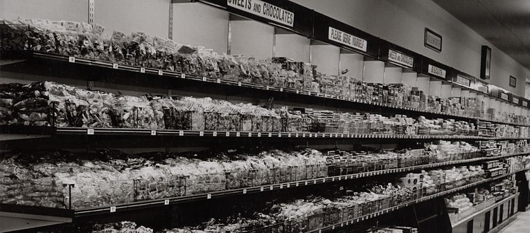 The original self-service stores dropped weigh-out products like pic'n'mix, replacing them with pre-weighed, standard size bags which were pre-packed at the factory