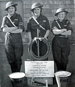The Stirrup Pump played a crucial role in Woolworths' blitz defences during WWII.  Here three colleagues from the Newton Abbot store show off their firefighting kit after winning the county championship in Devon in 1942.  They are Mrs. E. Tucker (née Spear), Mrs. Sanders (née Clements) and Miss D. Stone.