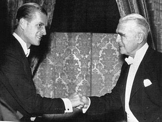 H.R.H. the Duke of Edinburgh shakes hands with retired Woolworths Chairman W. L. Stephenson, ackowledging the retailer's role as Commodore of the Royal Motor Yacht Club in the 1950s.