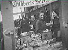 "Cuthbert Seeds in the temporary F. W. Woolworth store in Plymouth Market during World War II.  Vegetable seeds supported the ""Dig for Victory"""
