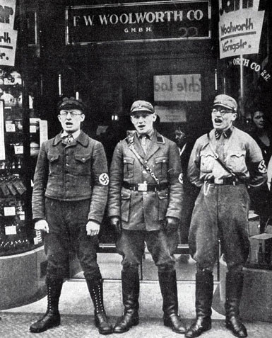 Soldiers from the German SA picket an F. W. Woolworth store with placards criticising the American owners and demanding a boycott of the chain