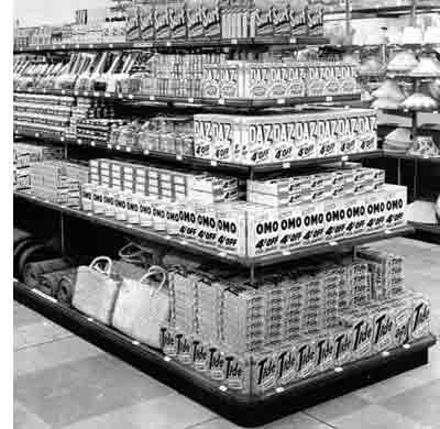 Soap powder and cleaning materials pictured at Woolworths in Kingsbury, London in 1956