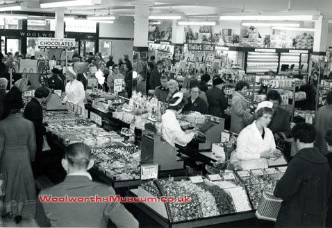 Customers throng around the confectionery counter at F.W. Woolworth, Pontypool, Gwent in 1954. (With special thanks to Reg and Ray Gallanders).