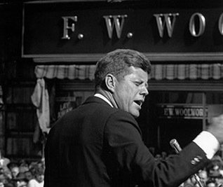 US President John F. Kennedy, speaking outside an F. W. Woolworth store