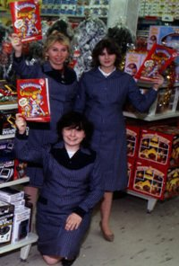 Store colleagues hold the latest issue of the Woolworths catalogue aloft in this publicity shot from 1983